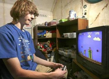 "Andrew Gardikis, at age 17, played ""Super Mario Brothers"" in his room."